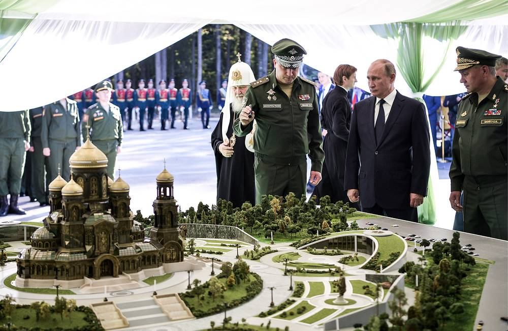 Patriarch Kirill of Moscow and All Russia, Deputy Prime Minister Timur Ivanov, Russian President Vladimir Putin, along with Defense Minister Sergei Shoigu look at a mockup of the Russian Armed Forces' main cathedral in Patriot Park, Moscow, September 19.  President Putin took part in the blessing of the foundation stone of Russian Army's main cathedral