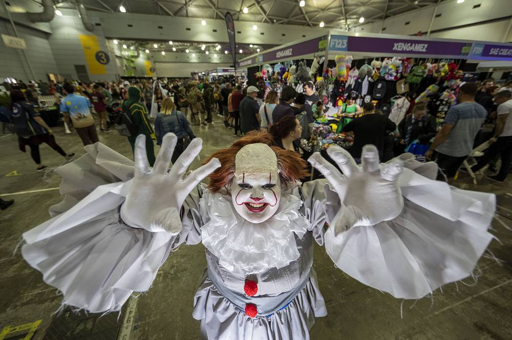 A cosplayer dressed as It, fictional character from the horror novel 'It', is seen posing for a portrait during the Oz Comic-Con at the Brisbane Convention and Exhibition Centre, in Brisbane, September 23