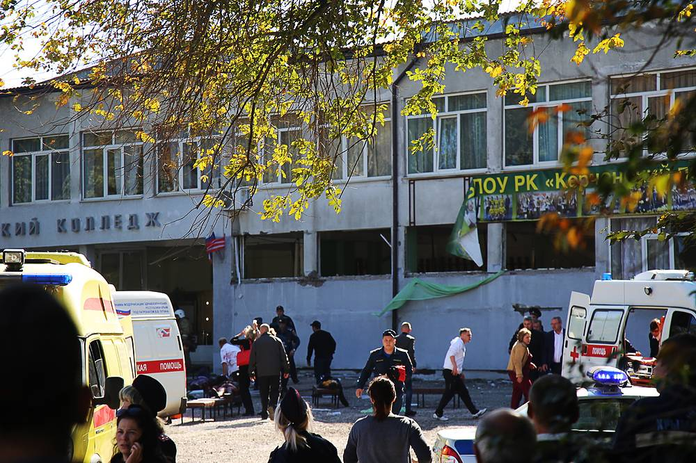 People at the site of the shooting and explosion at the Kerch technical college, Crimea, October 17