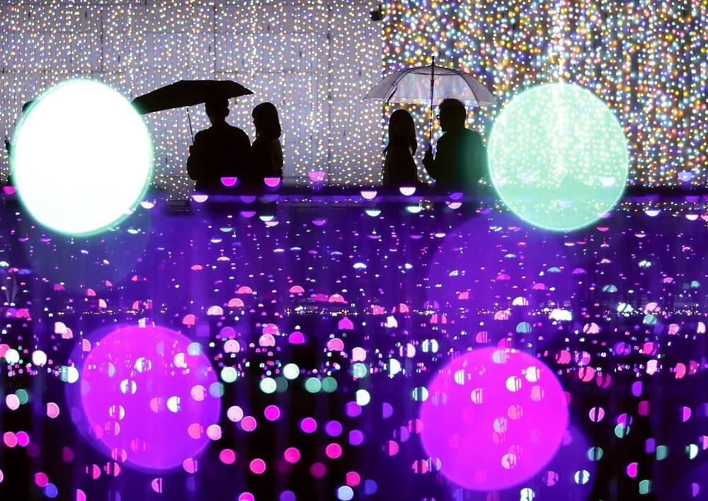 Visitors watch an illumination show at an amusement park in Tokyo, November 4