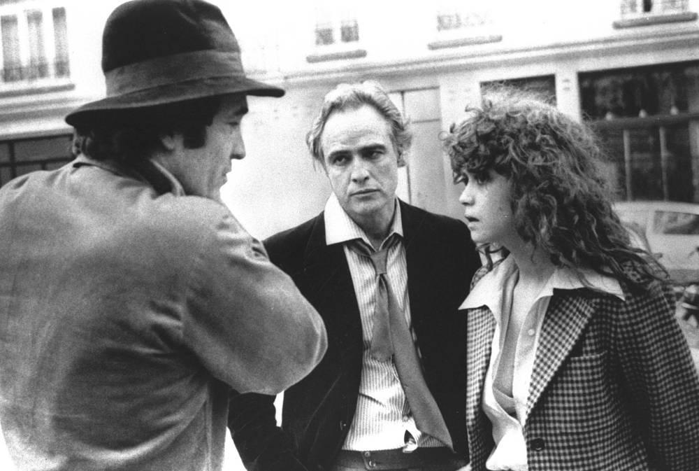 "Director Bernardo Bertolucci discusses a scene from ""Last Tango in Paris"" with leading actor Marlon Brando and actress Maria Schneider in Paris"