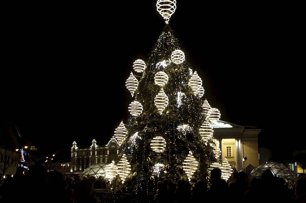 People enjoy city's Christmas tree at Cathedral Square in Vilnius, Lithuania