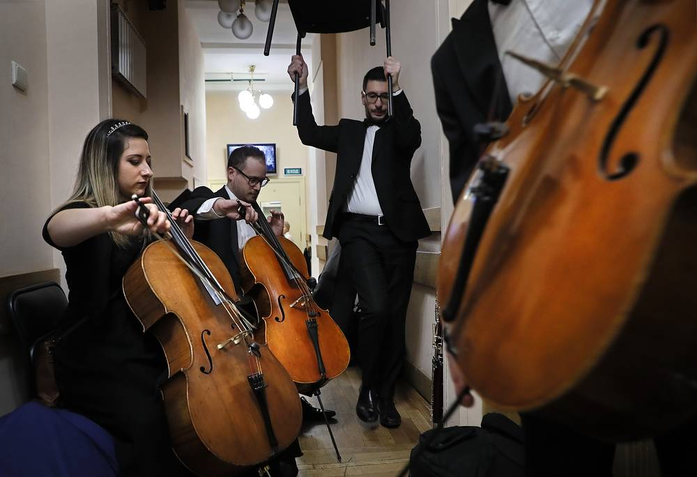 Members of the Malta Philharmonic Orchestra, the national symphony orchestra of Malta, rehearse before their performance at The Great Hall of Moscow State Tchaikovsky Conservatory, in Moscow, December 5