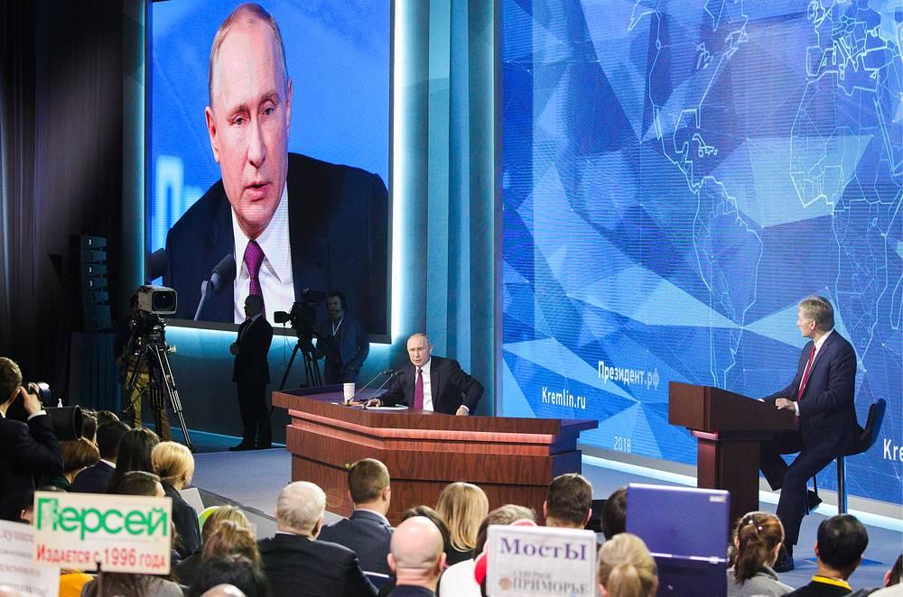 Russia's President Vladimir Putin and his spokesman Dmitry Peskov