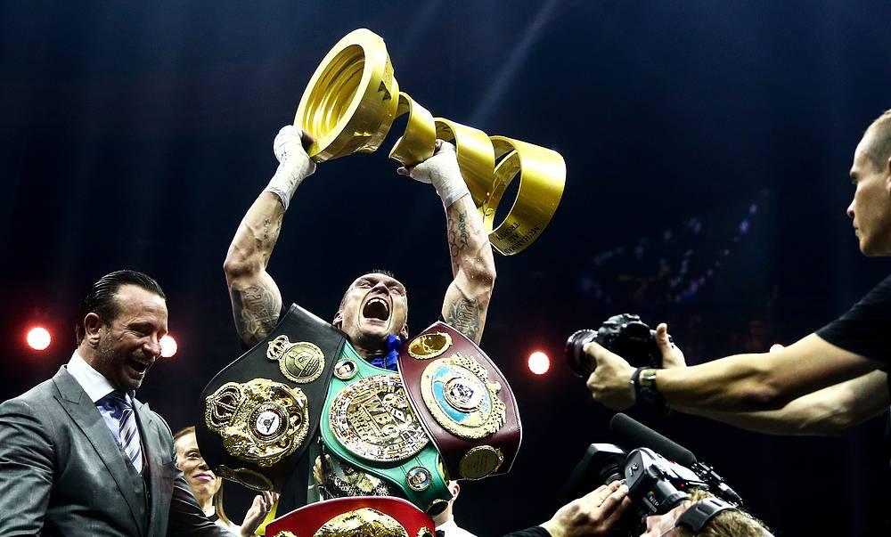 WBC/WBO champion Oleksandr Usyk of Ukraine, lifts the Ali Trophy as he celebrates winning his WBSS (World Boxing Super Series) cruiserweight final bout against WBA/IBF champion Murat Gassiev of Russia, at Moscow's Olympiyskiy Arena