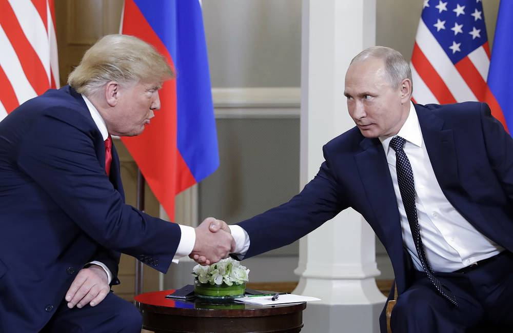 US President Donald Trump and Russia's President Vladimir Putin shake hands during a meeting at the Presidential Palace in Helsinki