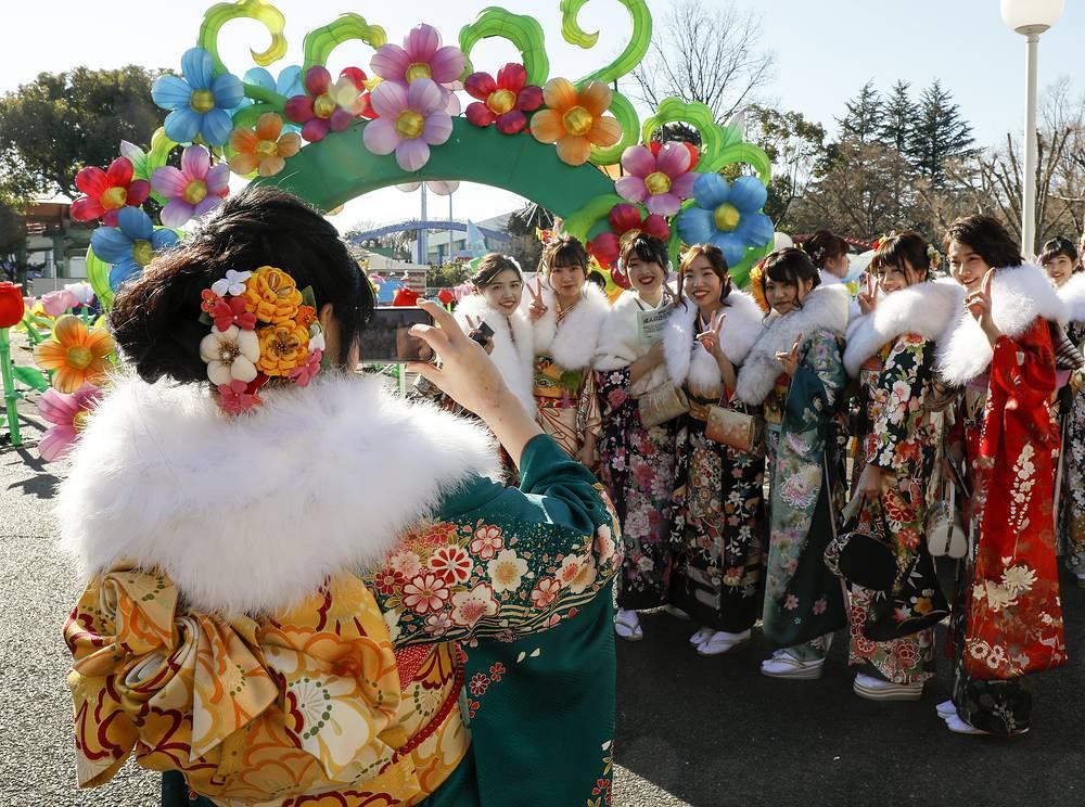 To mark the occasion, women traditionally wear furisode kimono