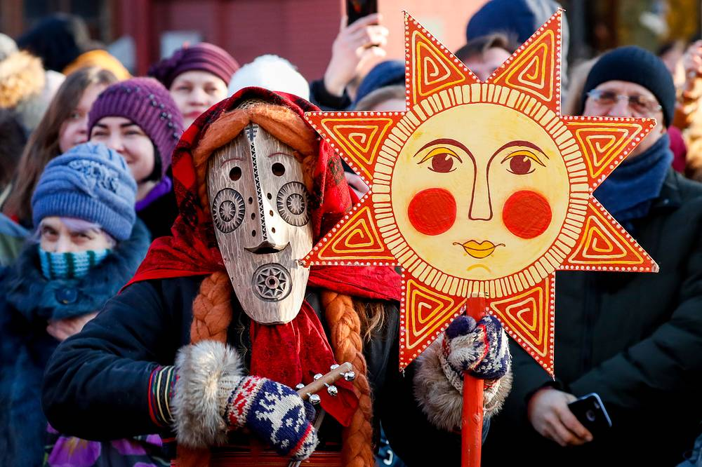 Performers are seen during the Maslenitsa festival on Manezhnaya square, Moscow, Russia