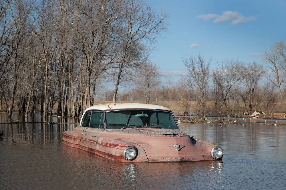 A vintage car is seen in flood water in Hamburg, USA, March 20
