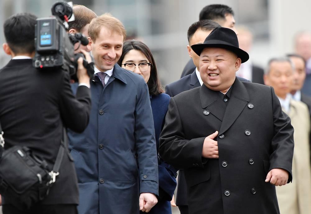 Russia's Far East development minister Alexander Kozlov and North Korean leader Kim Jong-un