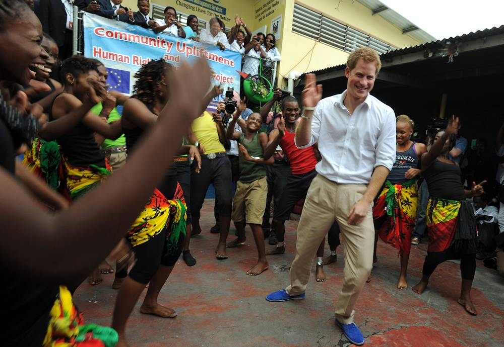 Britain's Prince Harry dancing during a visit to the non-governmental organization RISE in Kingston, Jamaica, 2012