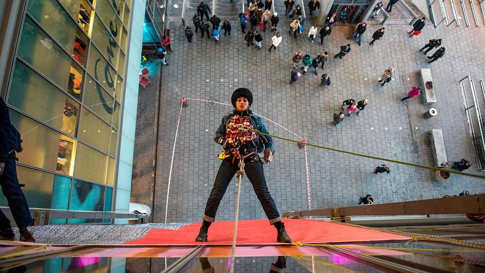 Female activist in a Copenhagen mall, 2012