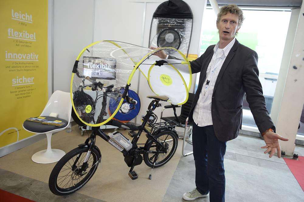 Складной тент для защиты велосипеда от дождя и непогоды, изобретение Рене Вютига (Швейцария)