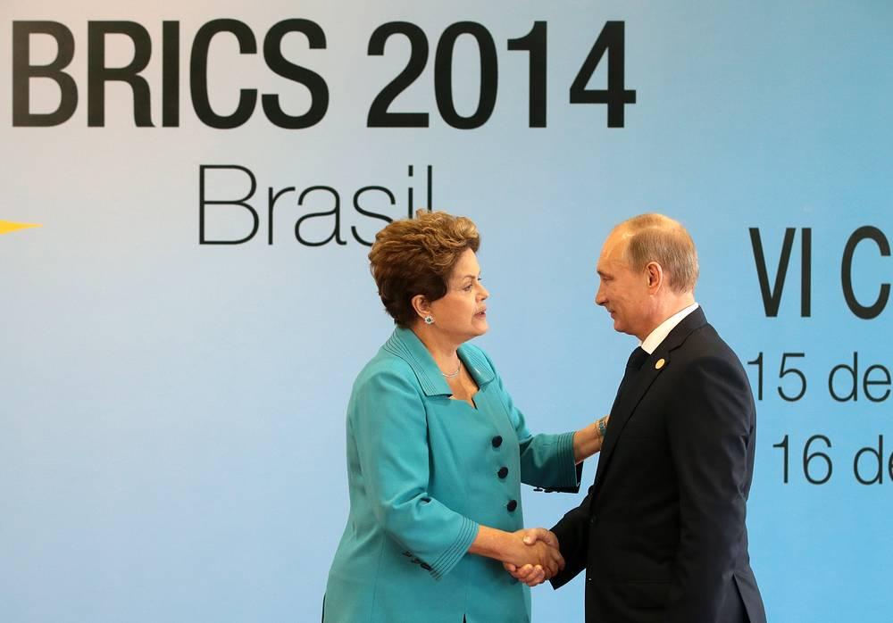 Президент России Владимир Путин и президент Бразилии Дилма Роуссефф во время встречи перед началом саммита БРИКС