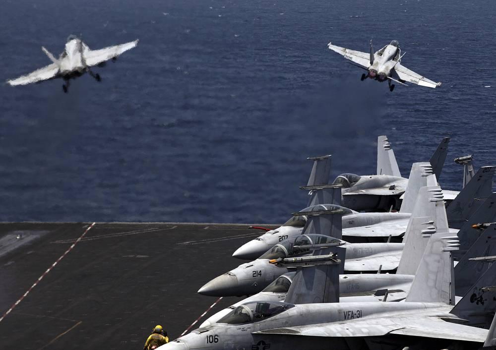 """8 августа США начали военную кампанию против террористической группировки """"Исламское государство"""". Удары по позициям боевиков наносятся с воздуха"""