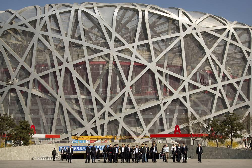 XXIV зимние Олимпийские игры, Пекин. Столица Китая получила право принять Игры-2022 на сессии МОК в Куала-Лумпуре. Этот город стал первым который примет у себя как летние, так и зимние Игры. (На фото: визит комиссии МОК в Пекин для инспекции города на проведение Олимпиады-2022)