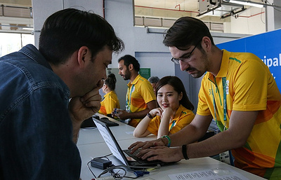 Russian professor from US works as volunteer at Olympic press center in Rio