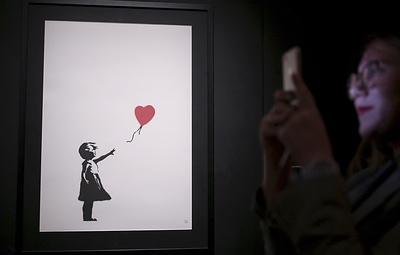 Бэнкси уничтожил свою картину во время аукциона