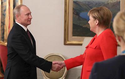 Путин провел рабочий завтрак с Меркель в Буэнос-Айресе