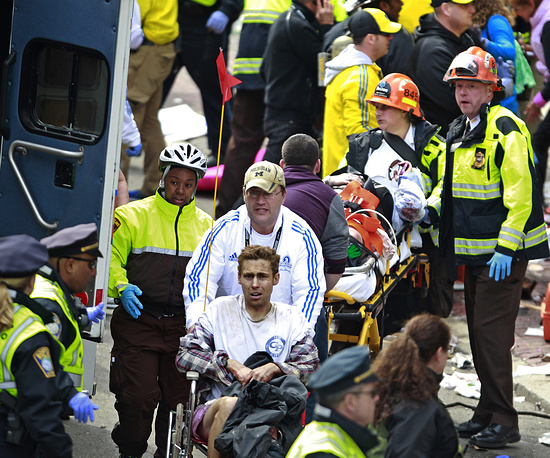 Medical workers aid injured people at the finish line of the 2013 Boston Marathon following an explosion Monday, April 15, 2013 in Boston.