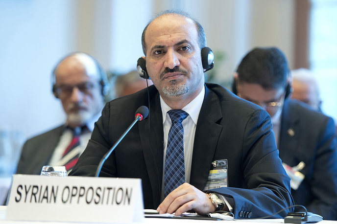Syrian National Coalition President Ahmed al-Jarba attends the start of the Syrian peace talks in Montreux