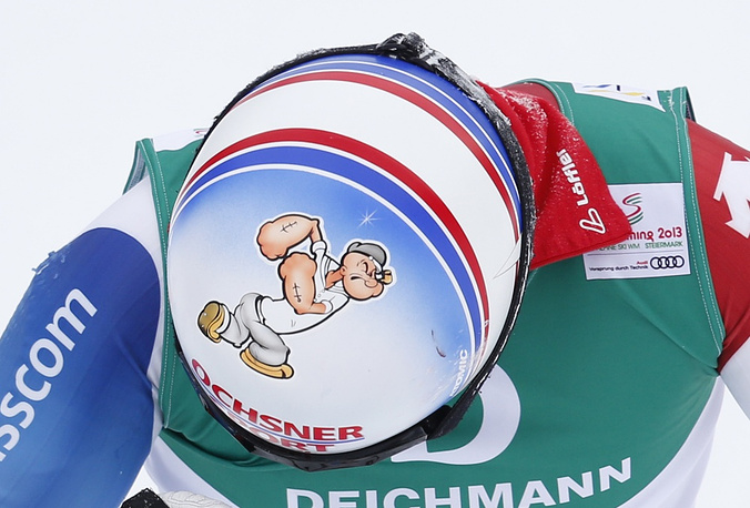 Switzerland's Gino Caviezel showing a painting of Popeye on his helmet
