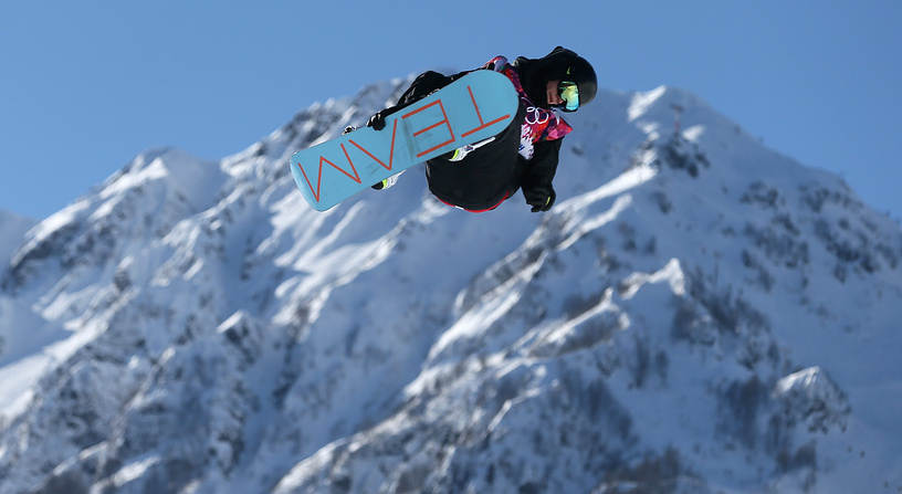 Jan Scherrer of Switzerland during his first run in heat two of the Men's Snowboard Slopestyle qualification at Rosa Khutor Extreme Park at the Sochi 2014 Olympic Games, Krasnaya Polyana, Russia