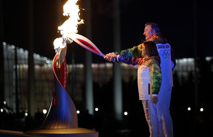 Vladislav Tretyak and Irina Rodnina lit the Olympic flame at the Fisht Stadium in Sochi