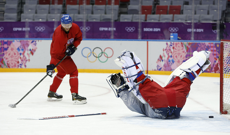 Czech Republic forward Jiri Novotny takes a shot against goaltender Jakub Kovar who was off balance after attempting to block another shot during a training session at the Bolshoy Ice Dome