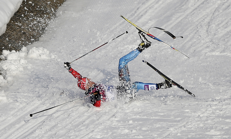 Russia's Anton Gafarov falls with a broken ski during his men's semifinal of the cross-country sprint