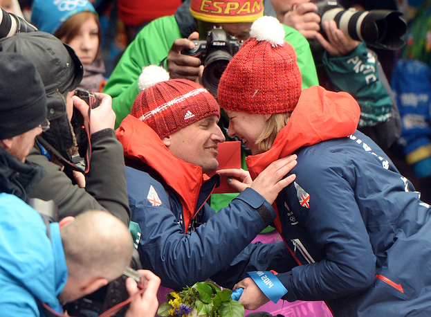 Elizabeth Yarnold of Britain celebrates with her boyfriend James Roche after winning gold in the women's Skeleton competition