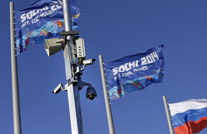 A bank of security cameras hang from a pole in Olympic Park