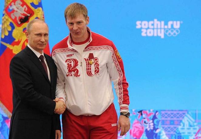 Vladimir Putin  awarding bobsledder Alexander Zubkov