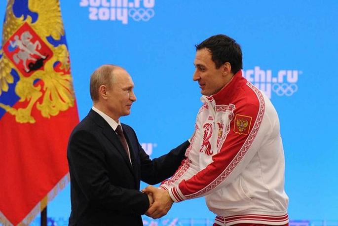 Vladimir Putin congratulating Alexei Voevoda