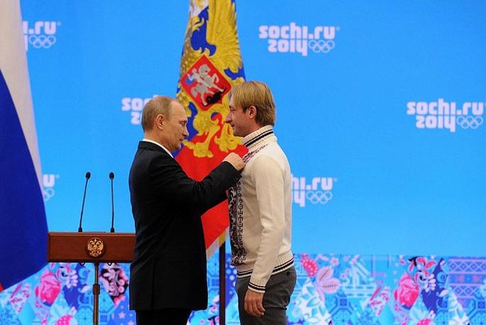 Vladimir Putin awarding figure skater Evgeni Plushenko