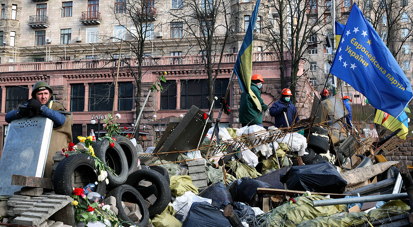 Protesters still keep on guarding the barricades in downtown Kiev, though clashes have stopped