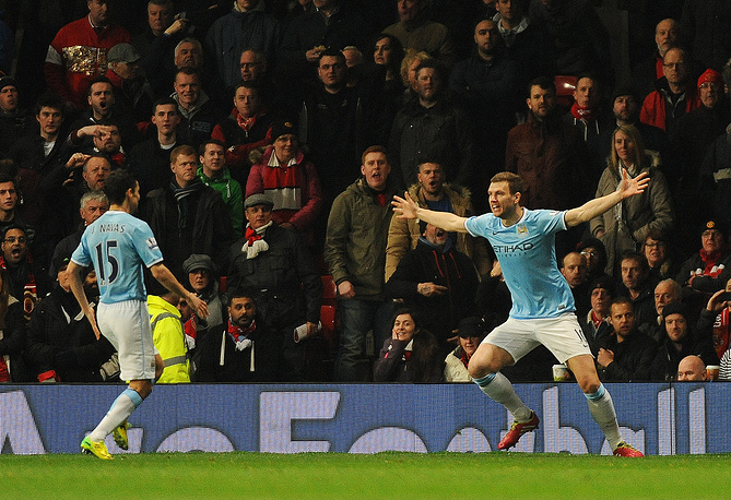 Edin Dzeko (R) celebrates after scoring the 1-0