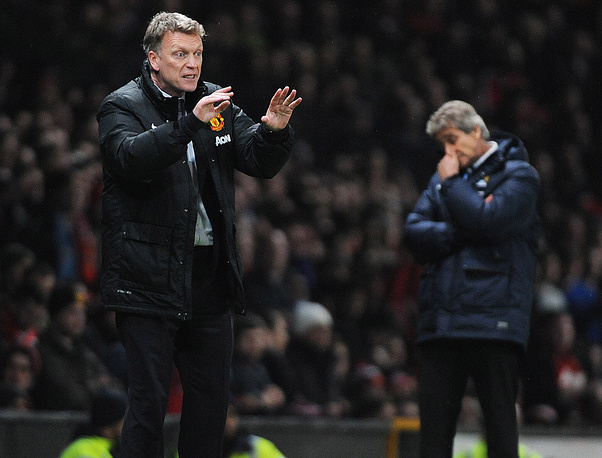 Manchester United manager David Moyes (L) and Manchester City manager Manuel Pellegrini (R)