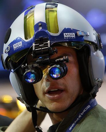 A pilot tests a helmet