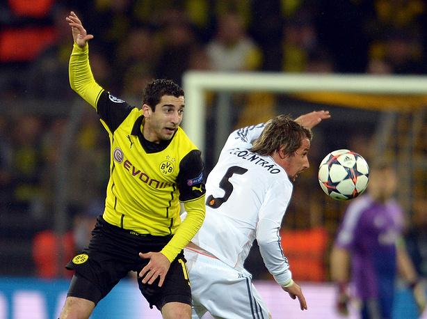 Dortmund's Henrikh Mkhitaryan (L) and Madrid's Fabio Coentrao