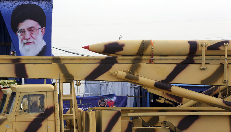 Missile seen in front of a portrait of the Iranian Supreme Leader Ayatollah Ali Khamenei