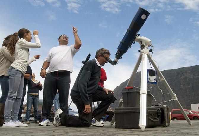People observe a solar eclipse on El Hierro island in Spain in 2013