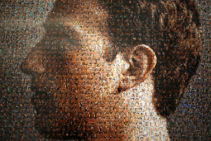 Portrait of Facebook founder Mark Zuckerberg made up of pictures of Chinese people in an exhibition titled 'The Face of Facebook'