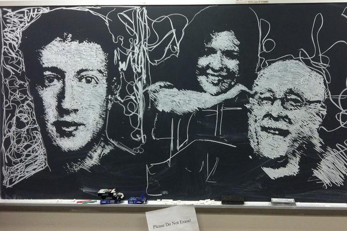 Mark Zuckerberg, Kara Swisher and Walt Mossberg depicted on a blcakboard at New York University