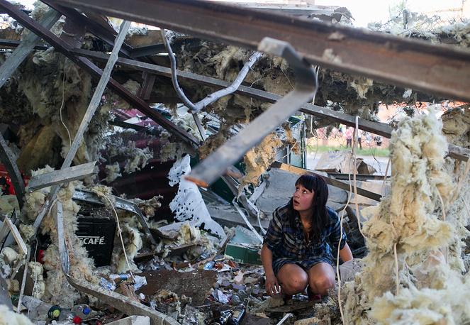 Kramatorsk residents at a shop destroyed during a Ukrainian forces shelling attack