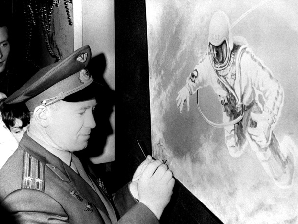Leonov signs one of his works in France, 1966