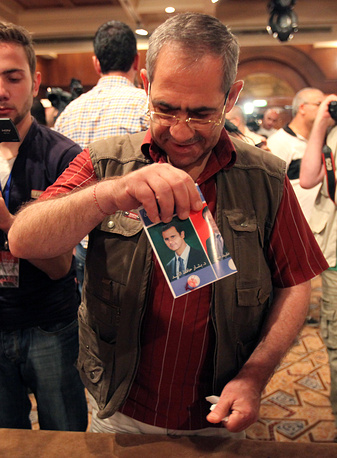 A voter who marked the election cards with his own blood in a show of loyalty for incumbent Syrian President Bashar Assad