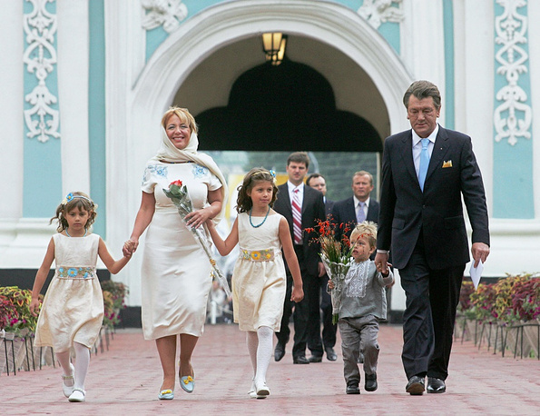 The couple have three children: Sophia (center), Khrystyna (left) and Taras (right)
