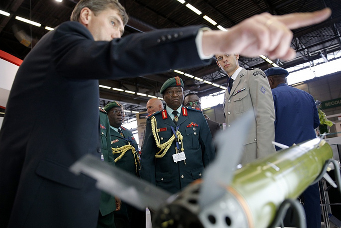 Tanzania military officers look at a missile