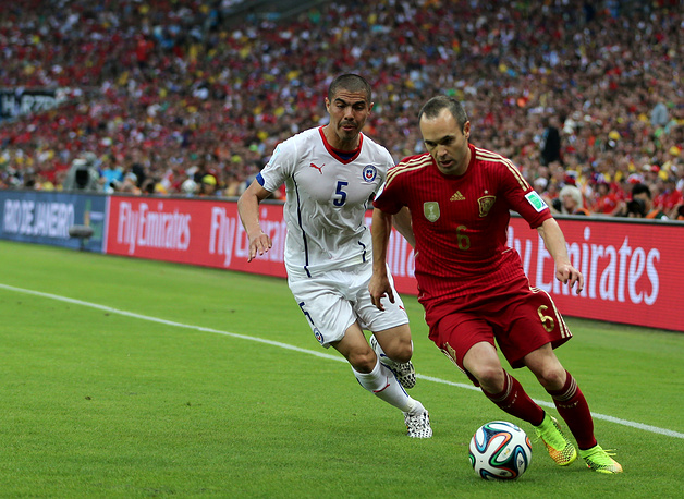 Andres Iniesta (R) of Spain in action with Francisco Silva (L) of Chile